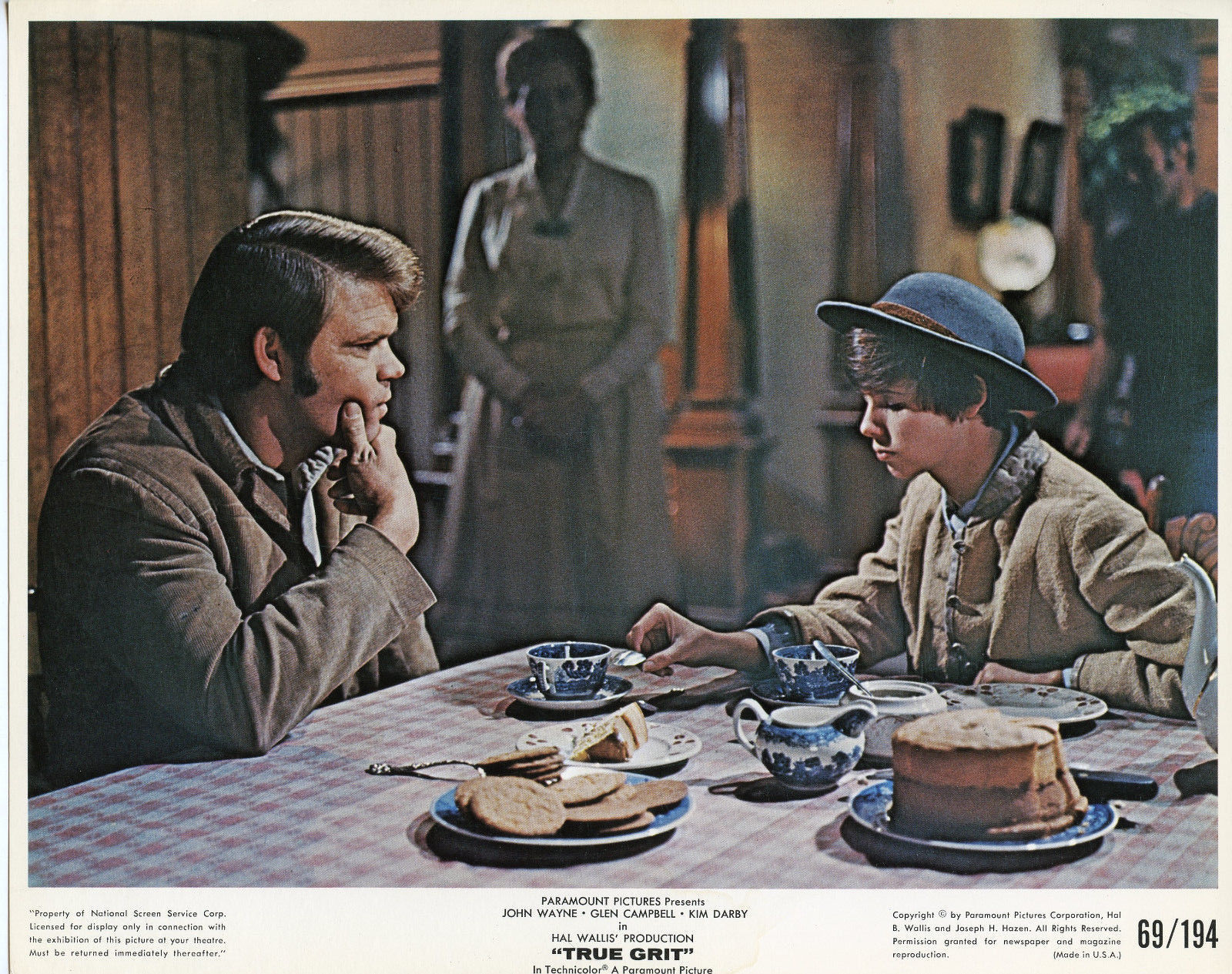 TRUE GRIT LOBBY CARD_MATTIE AND GLEN AT TABLE.jpg